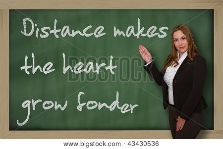 Teacher Showing Distance Makes The Heart Grow Fonder On Blackboard