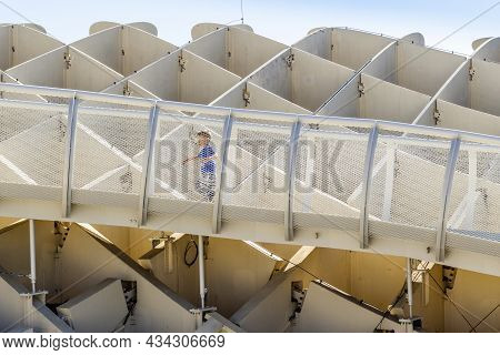 Small Boy Running On Walkways Of Setas De Sevilla - Wooden Construction With Walkways On The Roof In