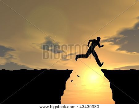 Concept or conceptual young man or businessman silhouette jump happy from cliff over  gap sunset or sunrise sky background