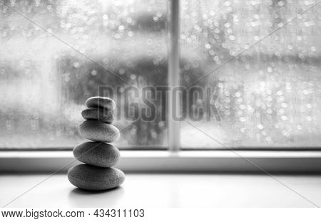 Pebble Tower With Blurry Green Rain Drops Outside Of Window Background, Black And White Stack Of Zen