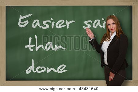 Teacher Showing Easier Said Than Done On Blackboard