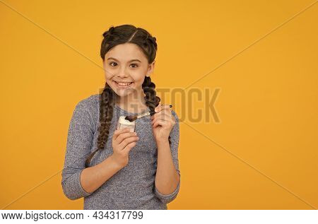 Cute Smile. Skin Beauty And Care. Childhood Happiness. Smiling Child On Yellow Background. Applying