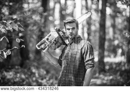 Poacher In Forest. Deforestation. Ranger Or Poach. Man Forester Use Saw. Search Firewood For Picnic