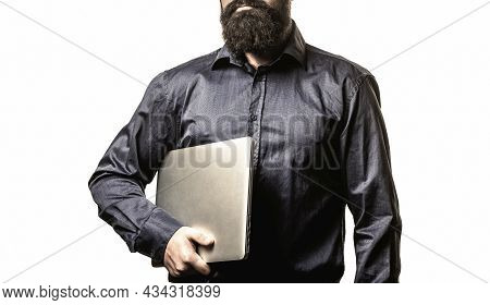 Holding Laptop Computer. Serious Handsome Bearded Man Worker Laptop. Bearded Male Businessman Holdin