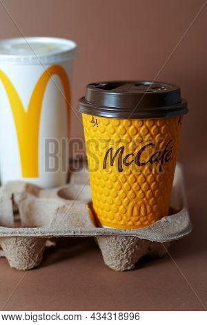 Yellow Glass Of Coffee Mcdonald's. Paper Glass Drink Mc Cafe. Two Cups On Table. Coca Cola And Orang