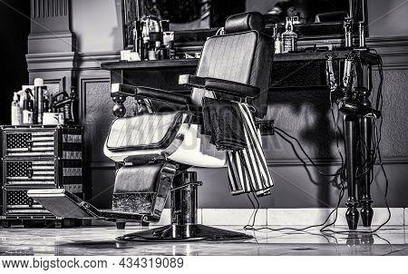 Barbershop Armchair, Modern Hairdresser And Hair Salon, Barber Shop For Men. Stylish Vintage Barber