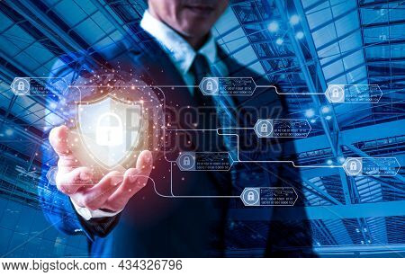 Data Protection And Cyber Security. With A Virtual Network Connection, A Businessman Holds A Padlock