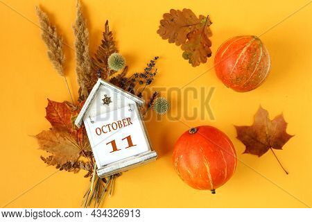 Calendar For October 11 : Decorative House With The Name Of The Month In English And The Number 11 O