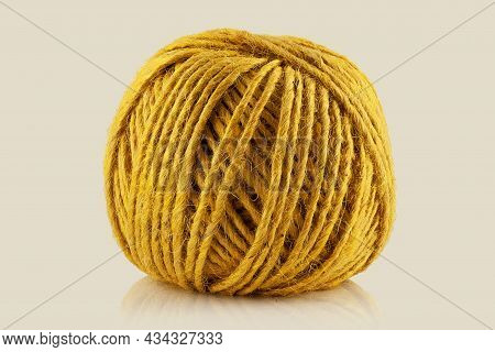 A Ball Of Twine On A Light Background