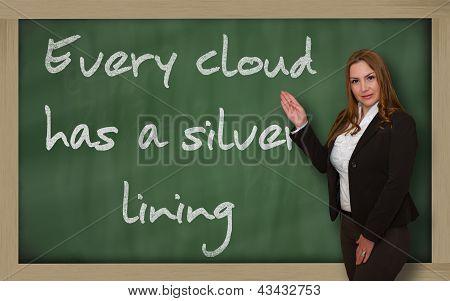 Teacher Showing Every Cloud Has A Silver Lining On Blackboard