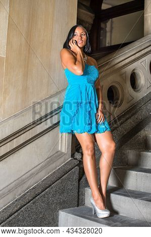 Dressing In A Blue Strapless Skirt Dress, Leaning On The Wall And Standing On Steps, A Black Teenage