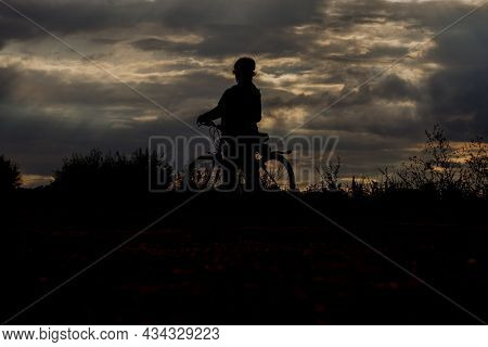 Silhouette Of A Cyclist In The Light Of The Setting Sun