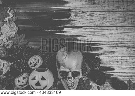 Halloween Human Skull, Halloween Maple Leaves On An Old Wooden Table In Front Of Black Background Wi