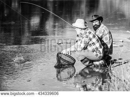 Concept Of Relaxation. Fly Fish Hobby Of Men In Checkered Shirt. Retirement Fishery. Two Male Friend