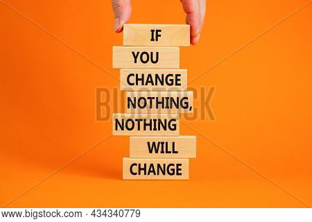Change Symbol. Wooden Blocks With Words 'if You Change Nothing, Nothing Will Change'. Businessman Ha