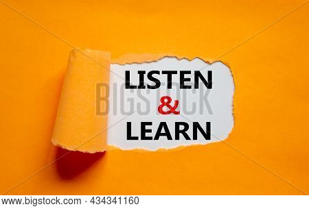 Listen And Learn Symbol. Words 'listen And Learn' Appearing Behind Torn Orange Paper. Beautiful Oran