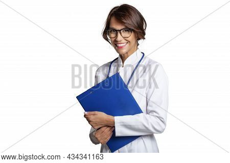 Female Doctor Standing At Isolated White Background While Holding Clipboard In Her Hand