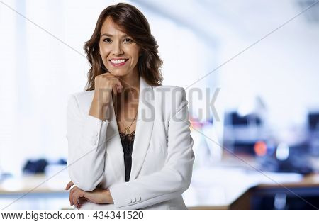 Confident Businesswoman Portrait While Standing At The Office