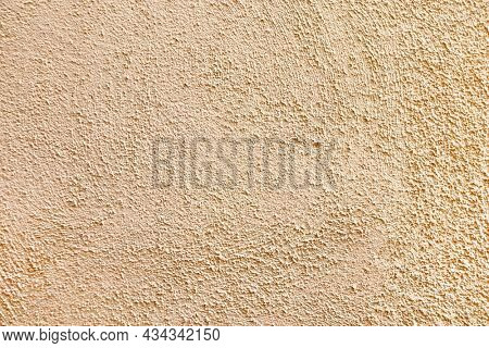 Horizontal or vertical  texture of old wall and stucco of beige color. Template of stucco of light brown color