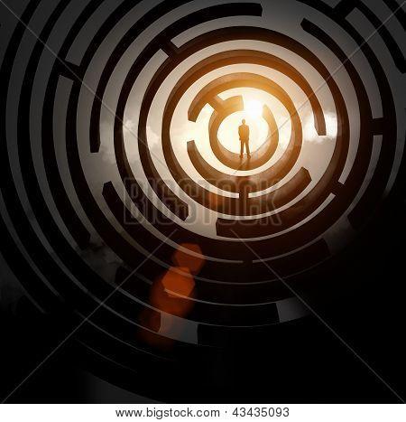 Silhouette of businessman in maze