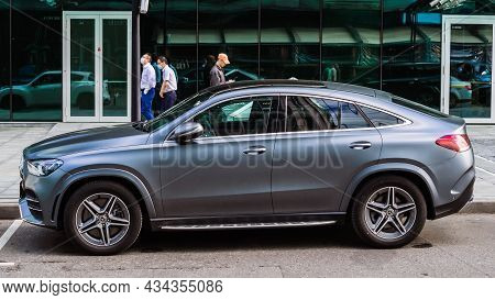 Moscow, Russia - August 2021: Mercedes Gle 53 Coupe Parked Next To Building With Glass Facade