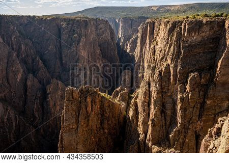 Rock Juts Out From Canyon Wall From North Rim Of Black Canyon Of The Gunnison In Colorado