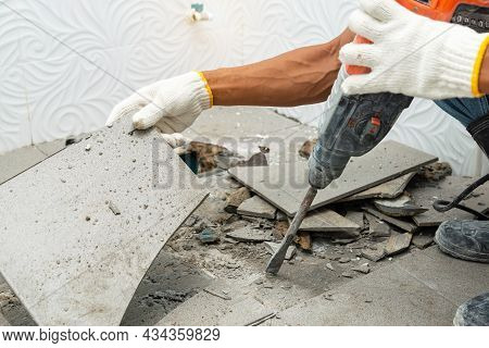 Worker Remove, Demolish Old Tiles A Bathroom With Jackhammer,  Toilet Repair,  Remodeling, Renovatio