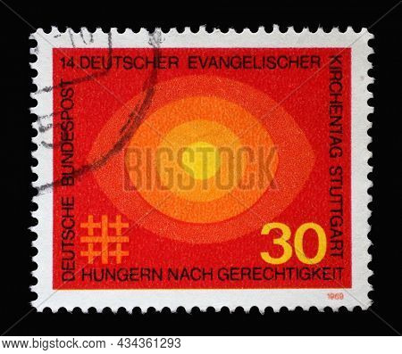 ZAGREB, CROATIA - JUNE 27, 2014: Stamp printed in Germany showing several circles in orange, 4th German Evangelical church day Stuttgart, hunger for justice, circa 1969
