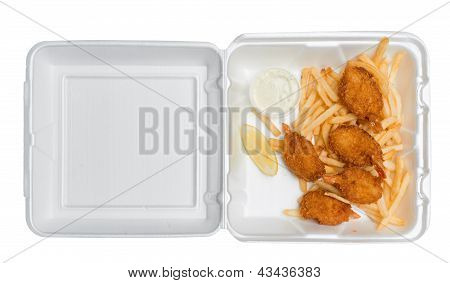 Fried Shrimp And French Fries In A Takeout Box