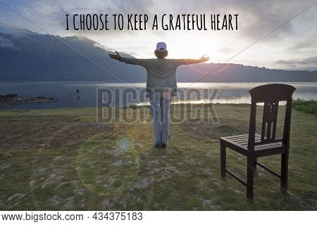 Inspirational Quote - I Choose To Keep A Grateful Heart. With Woman Standing Alone, Hands Raise With