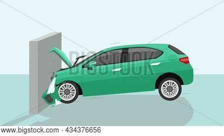 Crash Test Of Green Car Test Drive Impact Test Against Cement Wall. Hood Was Severely Damaged And Br