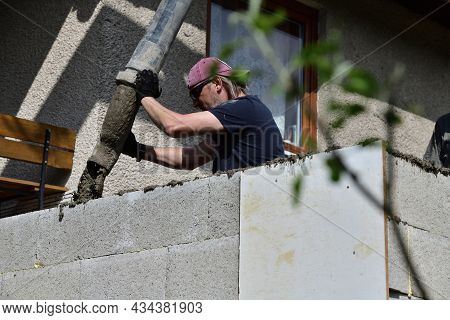 Concreting The Walls Using A Pump Machine During The Construction Of The House