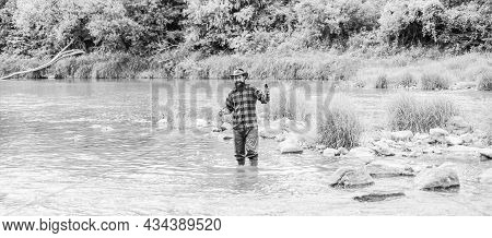Serious Play. Fisherman Show Fishing Technique Use Rod. Bearded Fisher In Water. Hobby And Sport Act