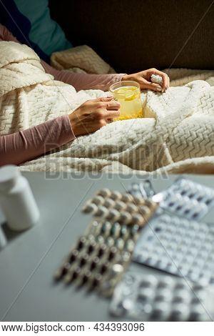 Sick Woman Holding Mug Of Warm Sea Buckthorn Tea