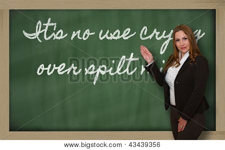 Teacher Showing It S No Use Crying Over Spilt Milk On Blackboard