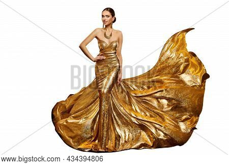 Woman In Long Golden Evening Dress Waving In Air. Elegant Fashion Model In Shiny Luxury Gown With Go