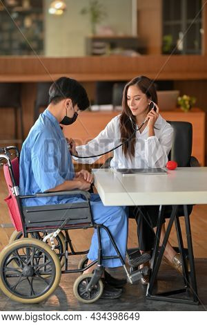 Doctor Hold Stethoscope To Checkup Disabled Patient Heart Rate