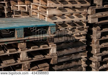 Big bunch of used wooden cargo pallets