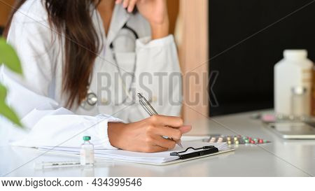 Cropped Shot Of Female Practitioner Or Pharmacist Writing A Medical Prescription