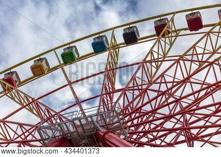 ferris wheel on a blue sky background