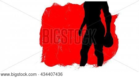 Mid section of silhouette of female handball player against red paint brush strokes. sports and competition concept