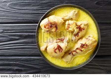 Indonesian Chicken Stew In Coconut Milk With Spices Close-up In A Bowl On The Table. Horizontal Top