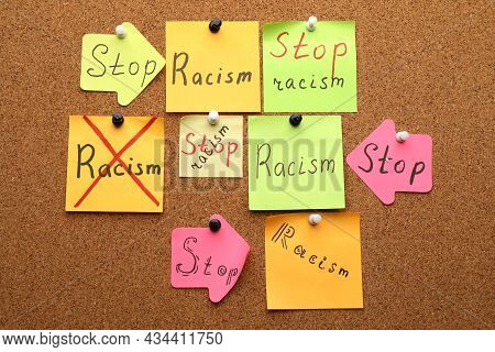 Paper Notes With Phrase Stop Racism Pinned To Cork Board