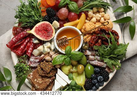 Set Of Different Delicious Appetizers Served On Light Grey Table, Flat Lay