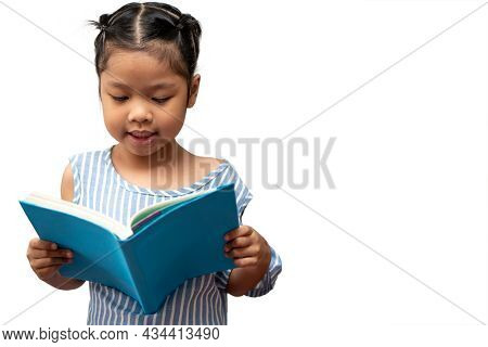 Happy Asian Little Preschool Girl Holding And Read A Book On White Isolated Background. Concept Of S