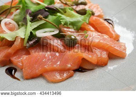 Delicious Salmon Carpaccio With Capers On Plate, Closeup