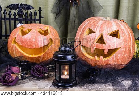 Halloween Decorations Concept At Night. Close Up Of Jack O'lantern, Glowing Vintage Lanterns, Scary