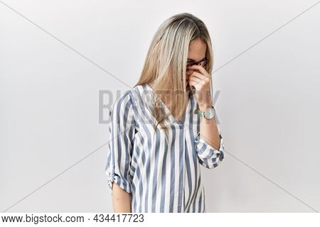 Asian young woman wearing casual clothes and glasses tired rubbing nose and eyes feeling fatigue and headache. stress and frustration concept.
