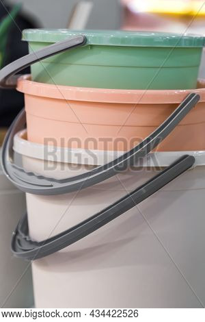 Various Plastic New Empty Buckets Stacked. Inventory And Household Items In Trendy Pastel Colors. In