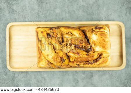 Homemade Bread With Dried Shredded Pork And Chili Paste Served On Wood Tray